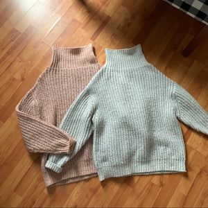 Two oversized chunky knit turtleneck sweaters